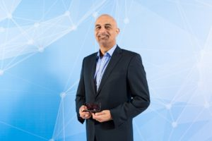 Yasser Zeineldin, CEO, eHosting DataFort with the SMB Managed Services Implementation of the year award.